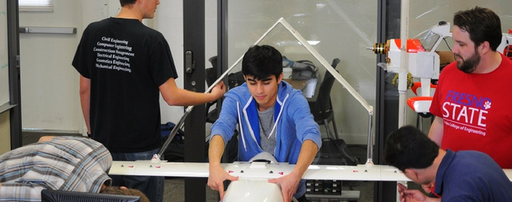 Students working on plane