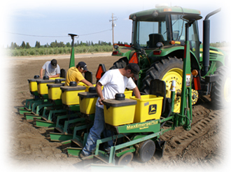 Students working on farm tractor